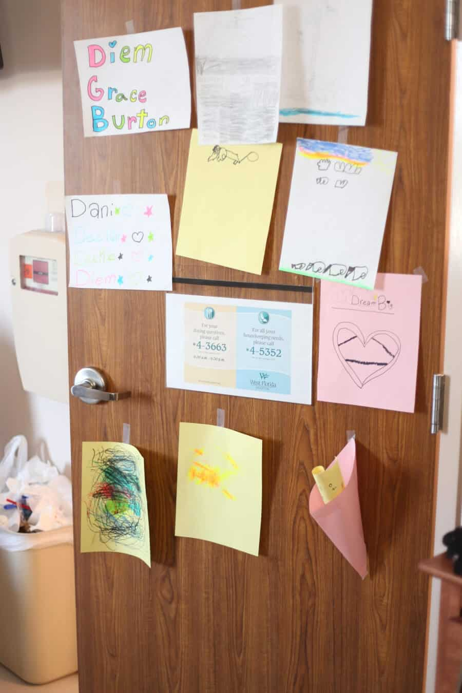 Notes and pictures the siblings drew for their mom are taped on the hospital door.