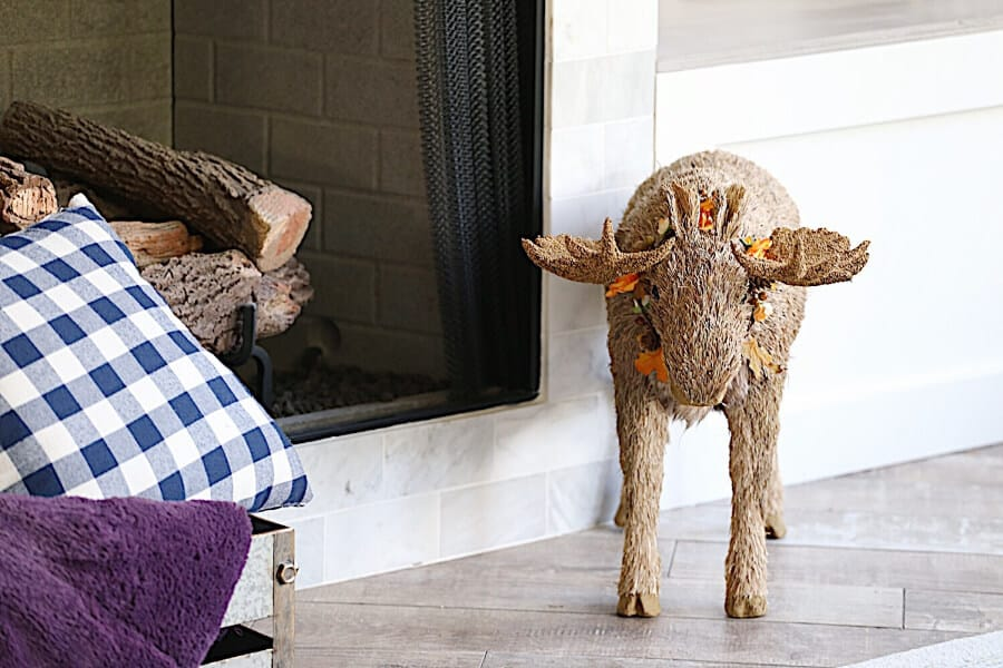 Fall Moose in front of a fireplace