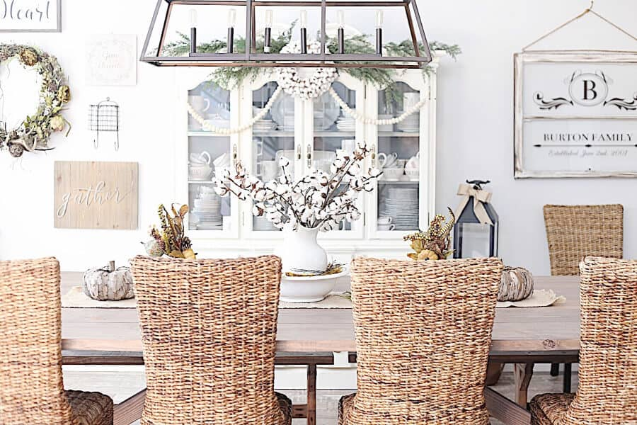 Farmhouse Dining Room with wicker chairs.