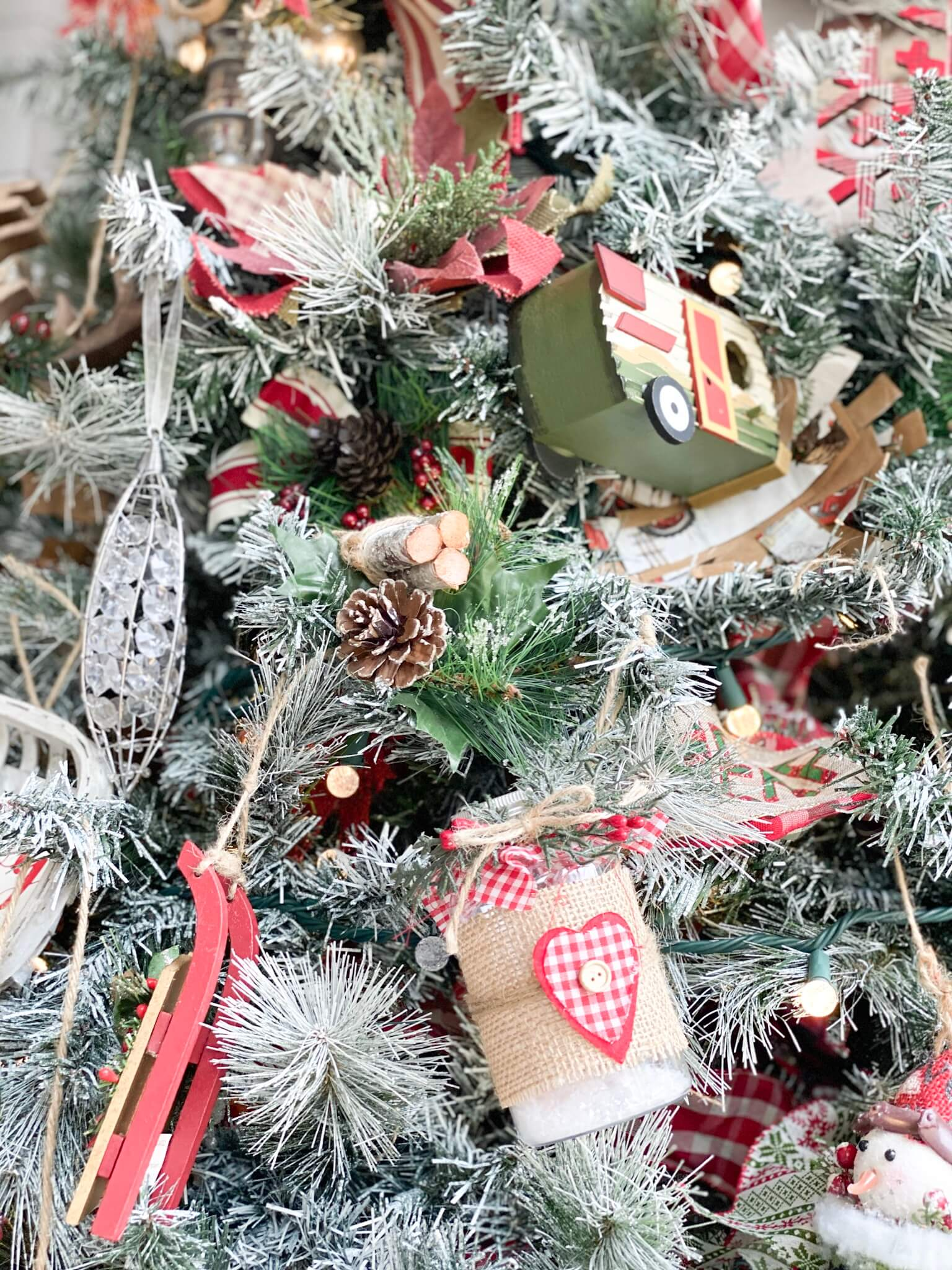Flocked Christmas Tree with different Rustic Christmas Ornaments