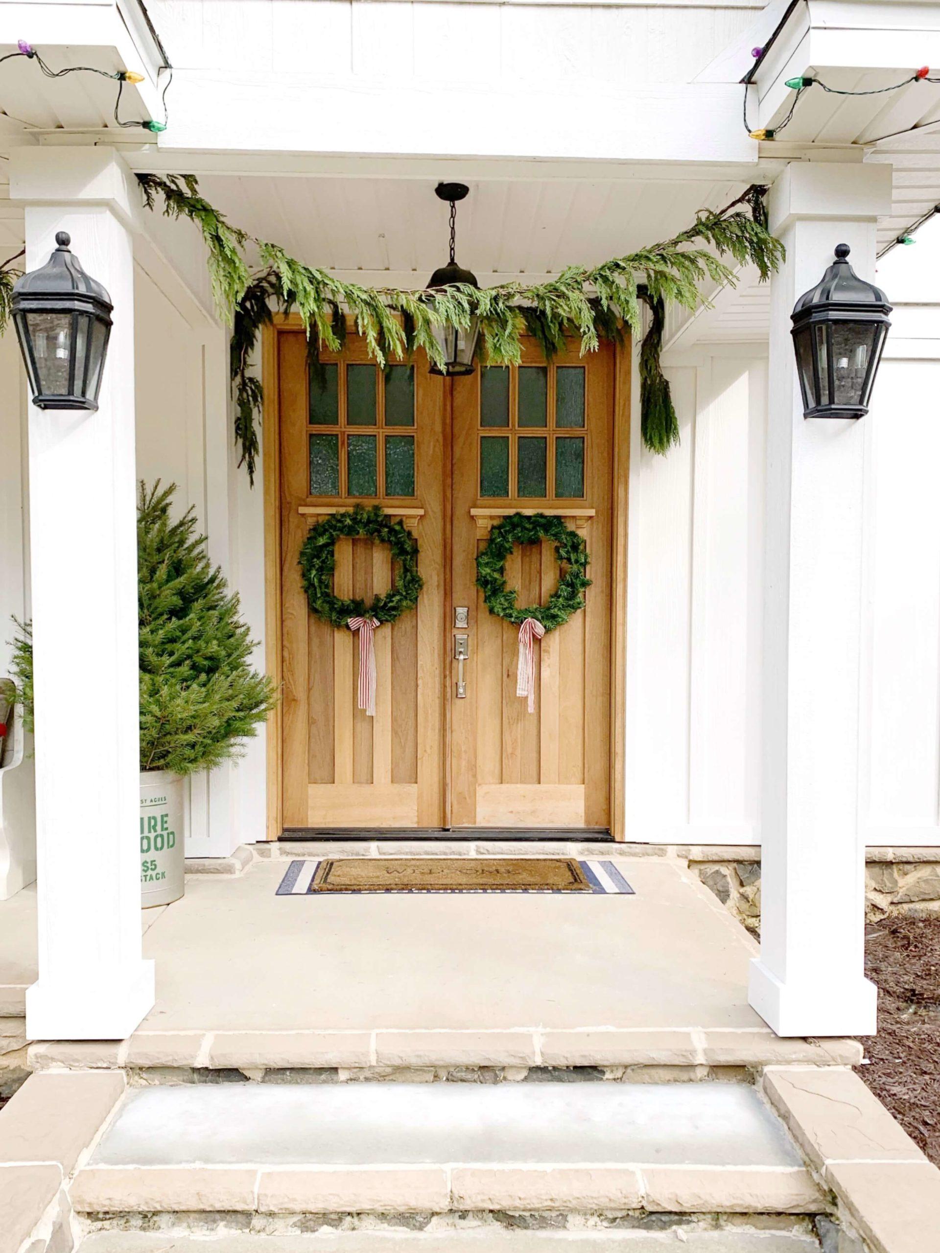 Scandinavian Christmas wreaths hunt on the front door.