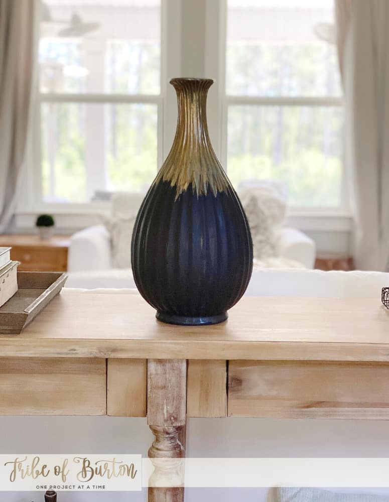Painted vase on sofa table.