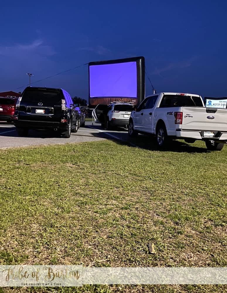 Lights are about to be turned off - looking at the screen at the drive in movie theater.
