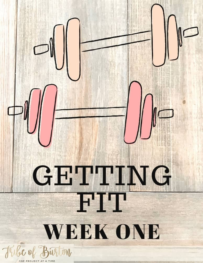 Pinterest Pin with dumbells and getting fit together with a wood background