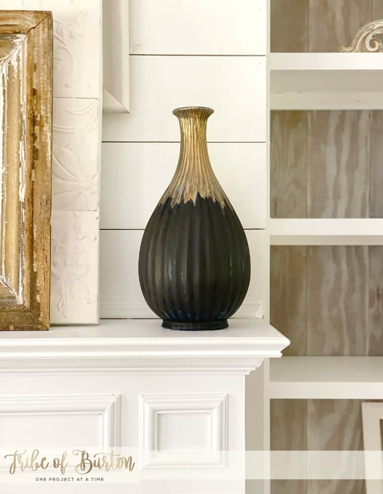 Painted vase on fireplace mantle