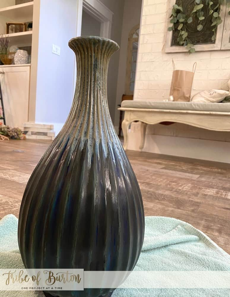 First coat of black chalk paint on vase. Waiting for it to dry