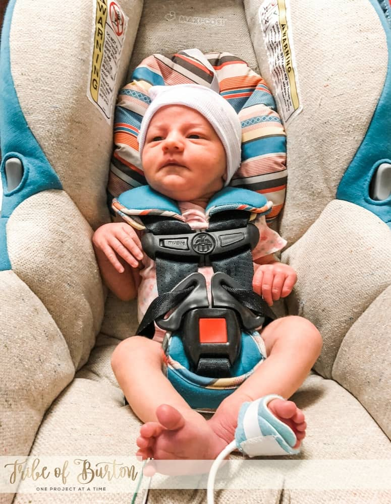A baby doing a NICU Car Seat test to make sure oxygen levels stay up.