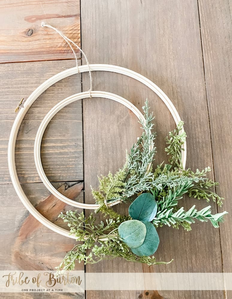 Hoop Wreath laid out on the table with greenery