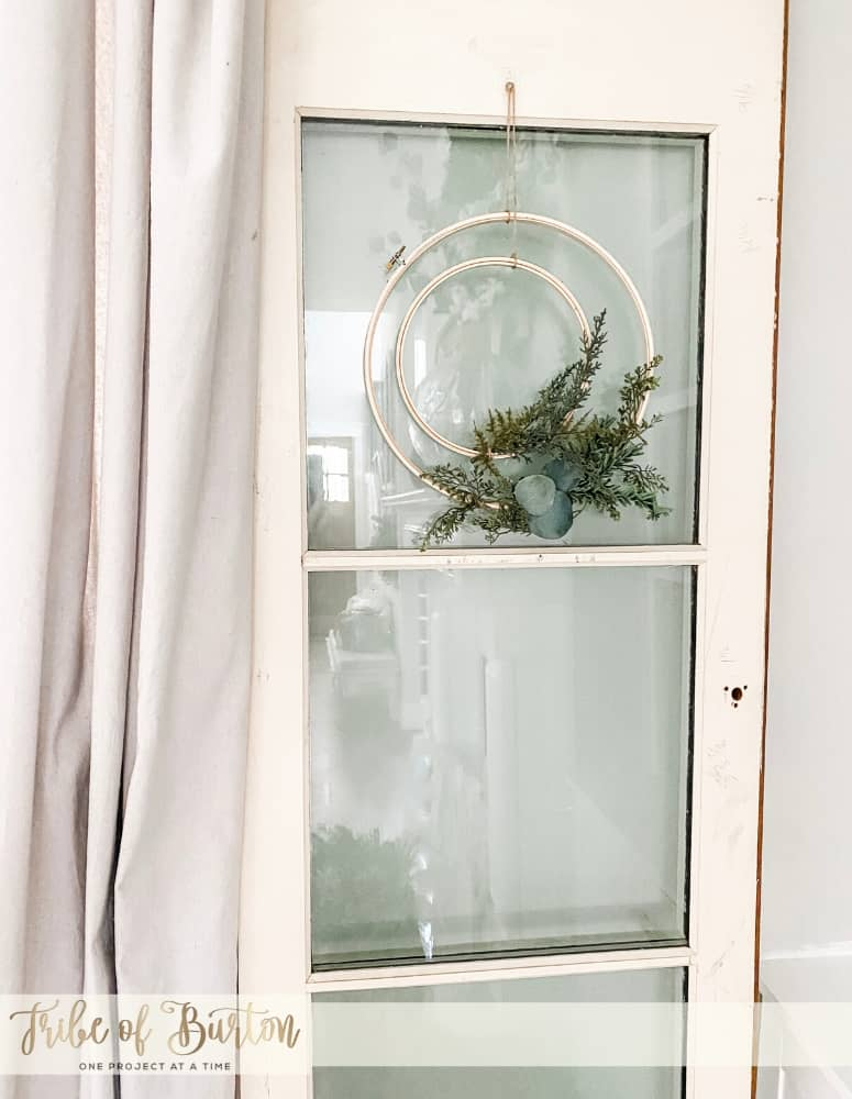 Embroidery Hoop Wreath on an old white door with glass.