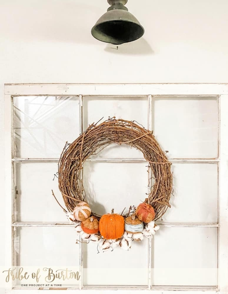 Fall Wreath hanging on an old window.